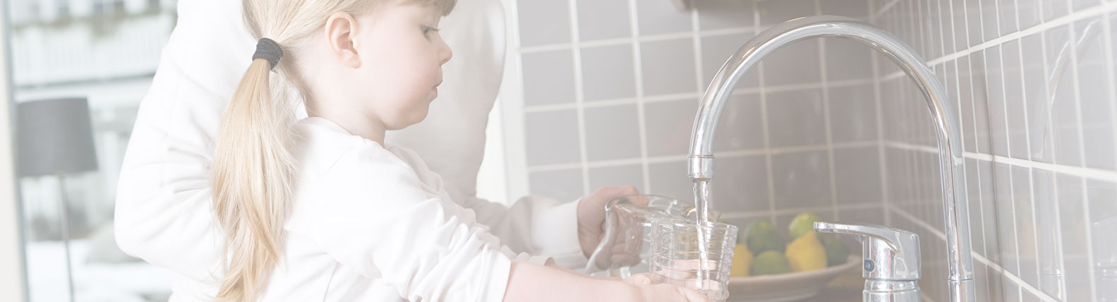 Child Filling Water Jug